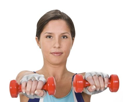 Portrait of a young woman doing barbells exercises.