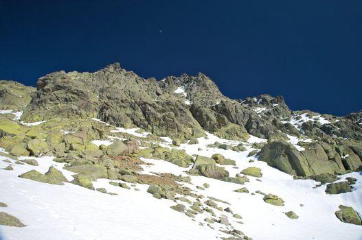peak snow mountain with moon