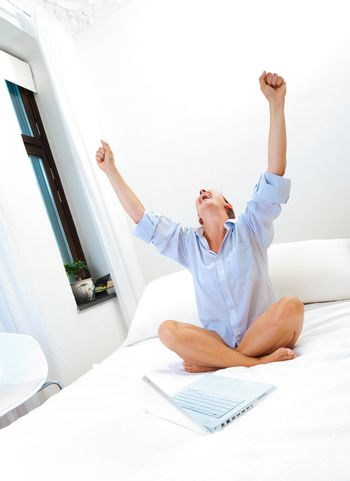 Successful woman working on bed