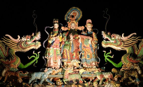 chinese god with dragon in the roof