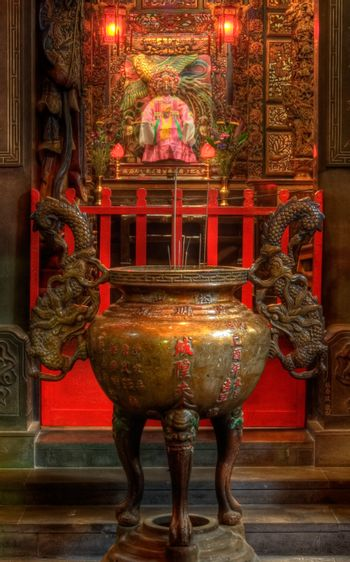 an chinese incense burner and god