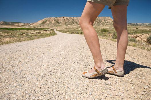 woman feet on desert road