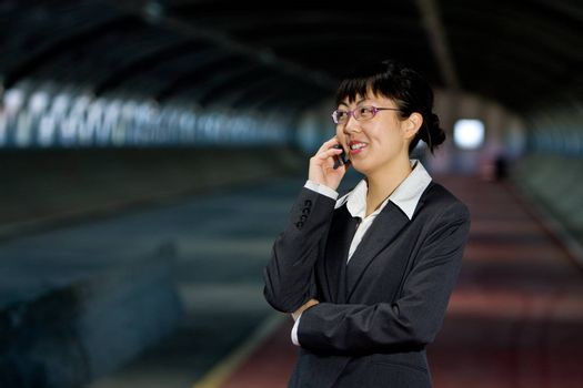 Asian business woman posing with mobile or hand phone, modern communication