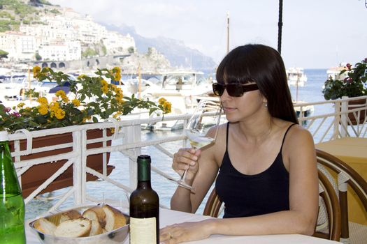 Drinking wine at an outside restaurant
