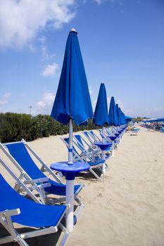 Closed beach umbrellas
