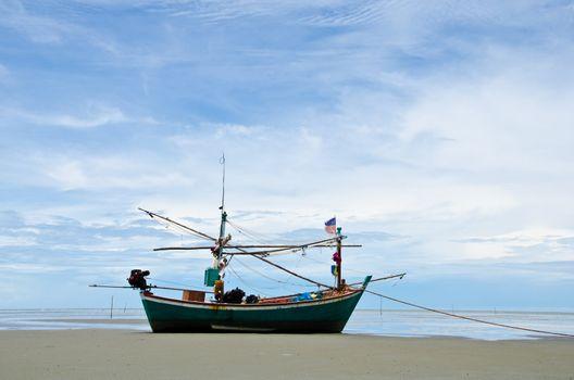 Coastal fishing boats anchor on the beach, Hua Hin, Thailand.