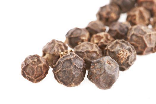 Black Peppercorn seeds on white