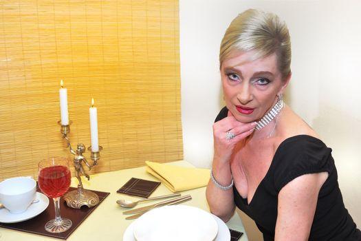senior woman waiting for dinner