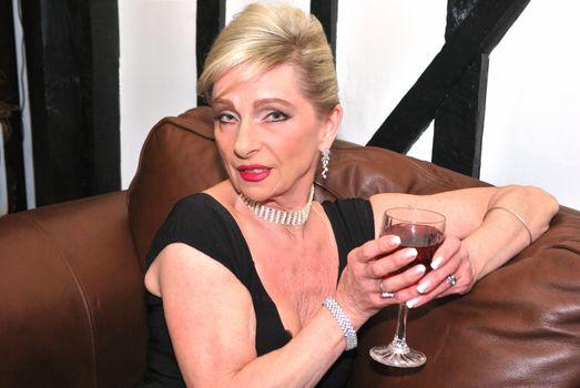 Senior woman enjoying an after dinner drink