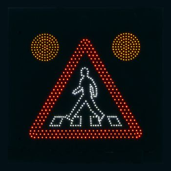 portrait of traffic sign warning for walking people