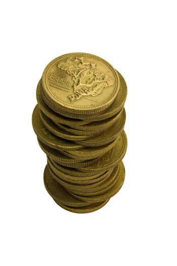Pile of old Brazilian coins in gold color