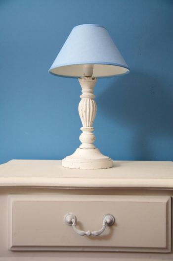 white lamp with blue lampshade