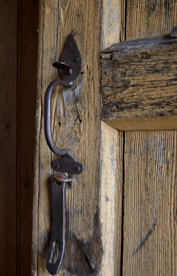 Old door handle and lock at the Museum of Lithuanian Culture in Rumsiskes