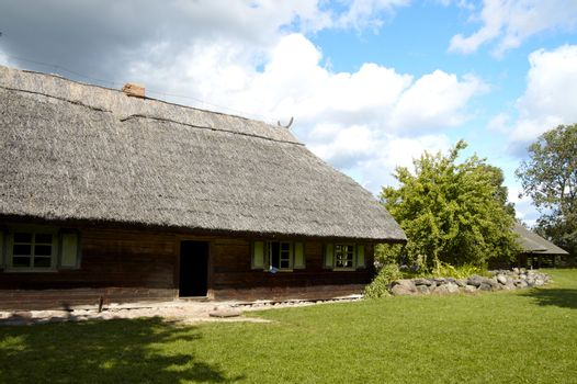 The old nineteenth century Lithuanian built house with straw roof