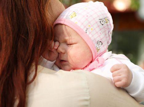 The newborn girl on mum's hands