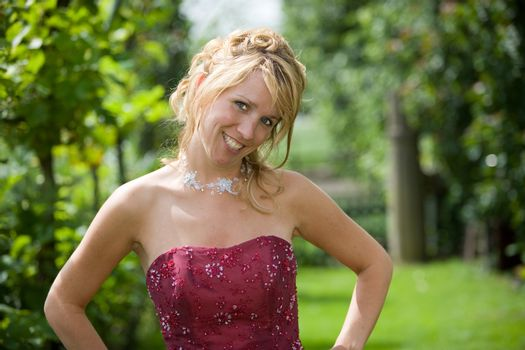 Beautiful blond bride on a sunny day with a radiant smile