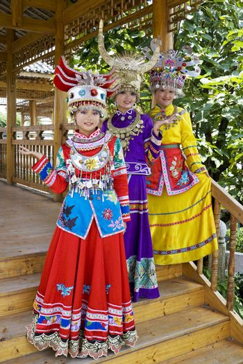 Image of young Chinese girls in traditional ethnic dress at Yao Mountain, Guilin, China.