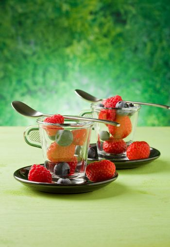 Berries inside a glass cup