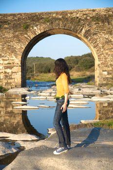 woman down the bridge arch