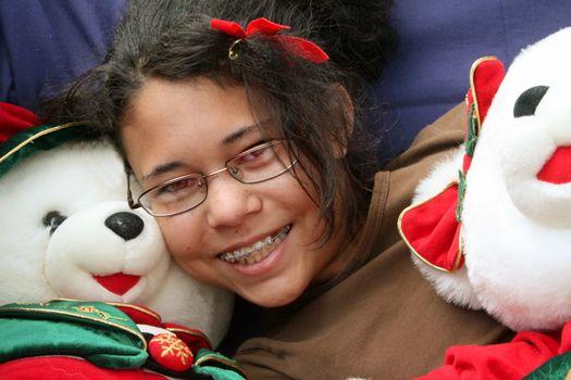 girl with stuffed Christmas bears
