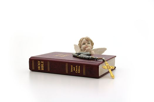 The bible and an angel on a white background.