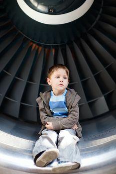 Boy inside turbine
