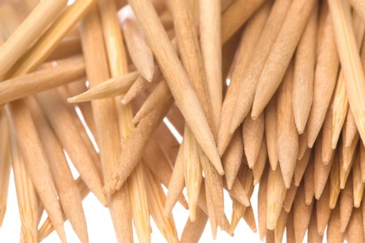 Isolated macro image of wooden toothpicks.