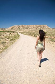hiking woman at desert road