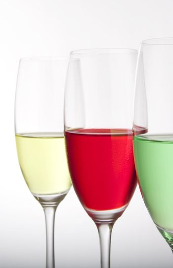 Row of three colorful cocktails