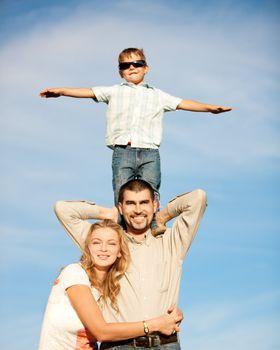 Family of three people enjoying summer day