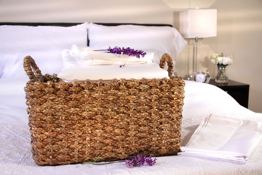 Linen basket with white sheets