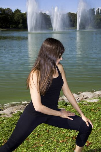 Woman doing a stretch in the park