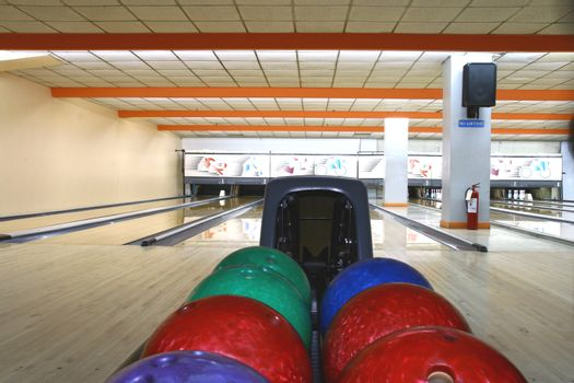 bowling balls with bowling lanes as background