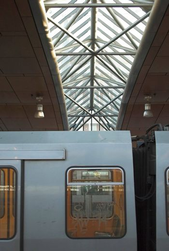 Detail of a metro train with a silhouette of a metro station roof