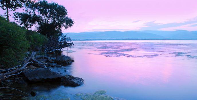 Sunrise on riverbank