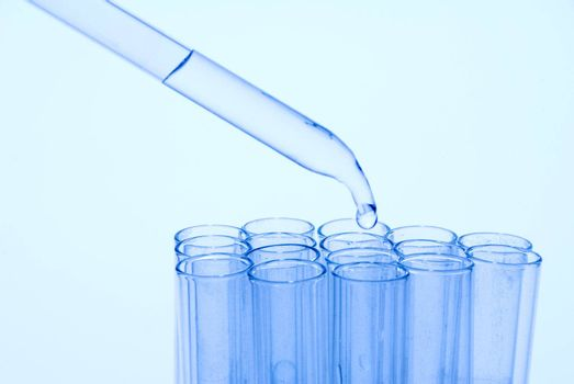 Test tube being fed with an eyedropper.