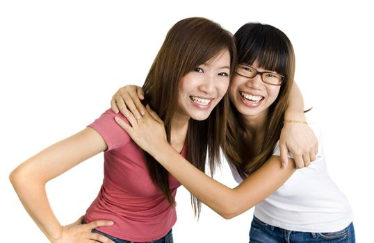 Young Asian college people on white background