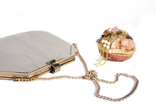 Female handbag with a chain and a casket.