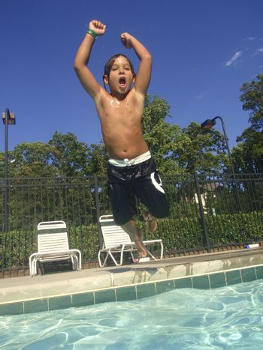Little boy at neighborhood pool