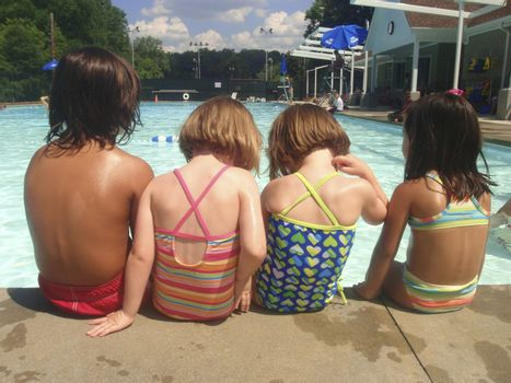 Little kids playing at neighborhood pool