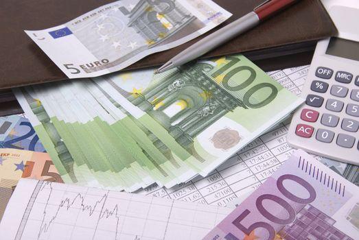 Paper money euro banknotes pen and calculator