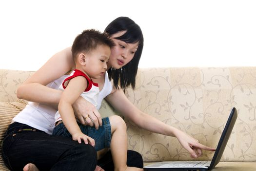 Young mother with her son using a laptop