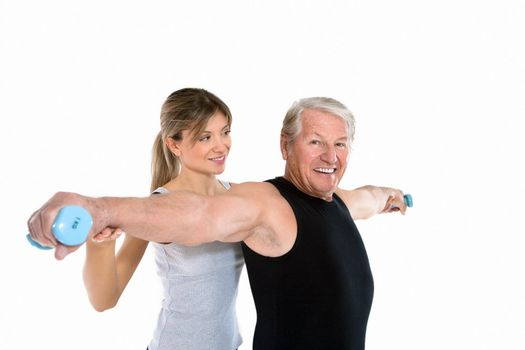 senior man and young woman exercising in gym. Copy space