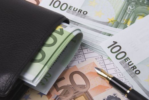Black purse paper money euro banknotes and pen