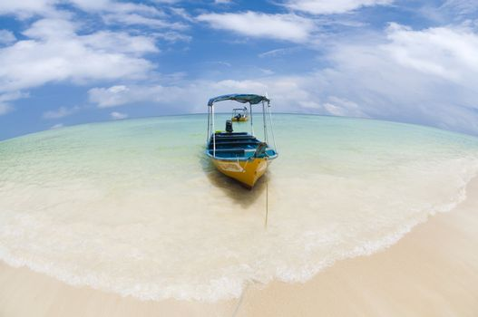 Taxi boat on a tropical beach, Pulau Perhentian, Malaysia.
