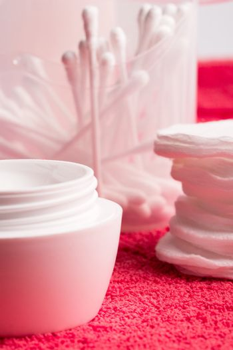 facial cream and cotton pads