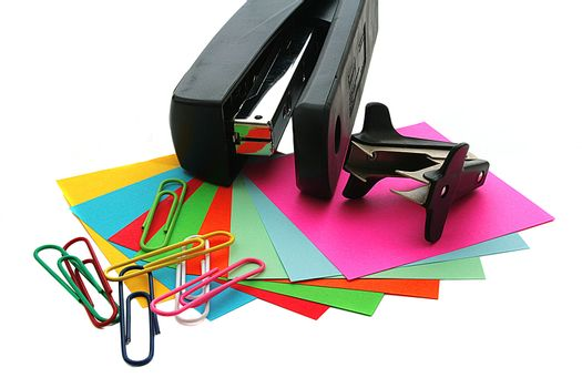 Colour sheets of paper for record with paper clips and a stapler.
