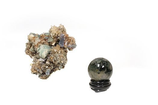 The granite polished sphere on a support and crystals for spiritualistic sessions.