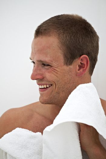 young man with a towel