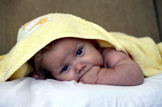 infant under a blanket